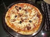 Ricetta pizza Pomodori secchi e Pancetta Foto